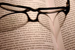 glasses-on-book-excerpt